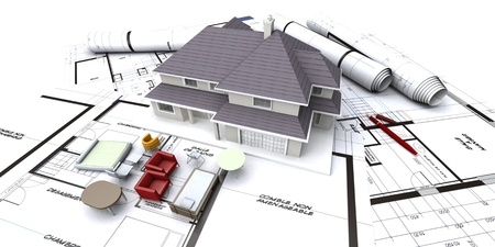 estate planning: House mockup on architect's blueprints with rolled-up plans and miniature furniture Stock Photo