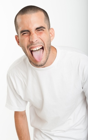 grimace: Young man sticking his tongue out