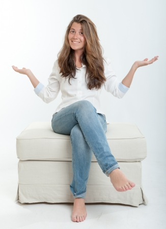 stool: Pretty young brunette sitting on a stool Stock Photo