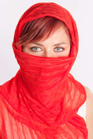 middle eastern ethnicity: Pretty woman in a red veil