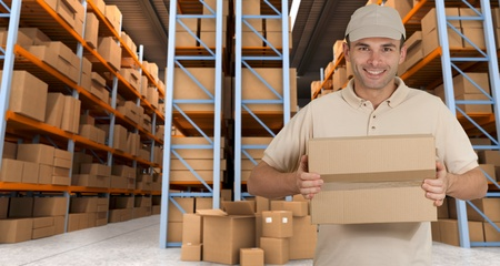 deliveryman: Deliveryman carrying a parcel in a distribution warehouse