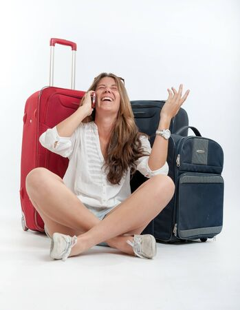 Young cute girl with luggage  talking on the phone  Stock Photo - 16192883