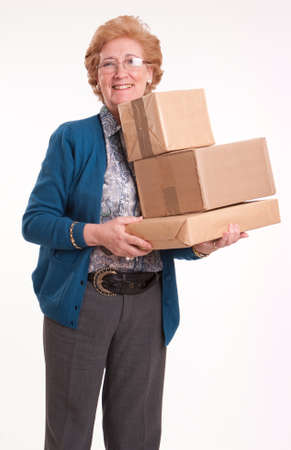 Smiling senior woman holding a package  photo