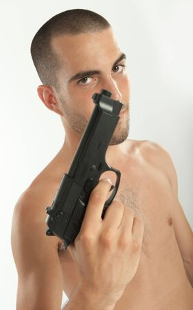 barechested: Bare-chested man holding a gun