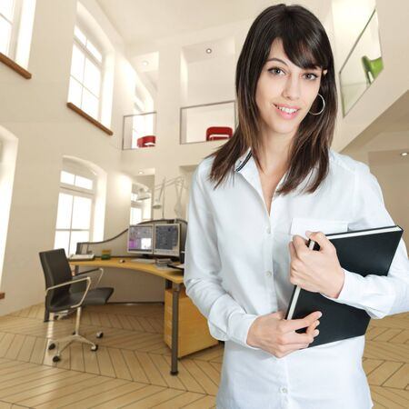 ledger: Young woman at the office holding a ledger