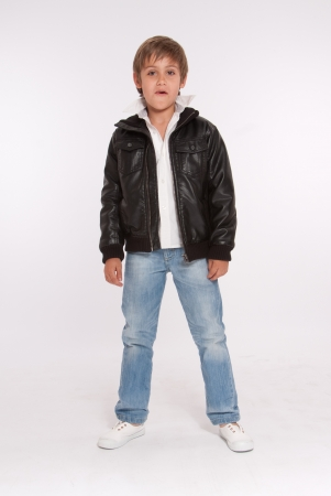 fashion boy: Little boy in blue jeans and a leather jacket