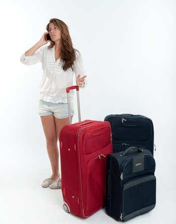 Young cute girl with luggage  talking on the phone Stock Photo - 16306053