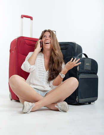 Young cute girl with luggage  talking on the phone Stock Photo - 16306085
