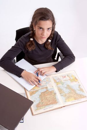 Young girl with a serious expression doing schoolwork  Stock Photo - 16306070