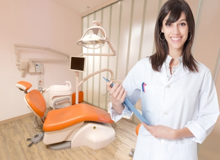 hygienist: Smiling young woman in a dental clinic Stock Photo