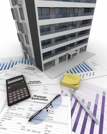 Apartment building on top of a table with mortgage application form, calculator, blueprints, etc    photo