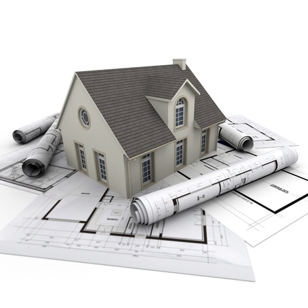 architecture project: House on top of architect blueprints Stock Photo
