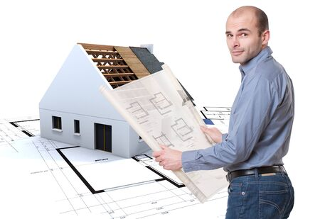 roofing:  Man holding plans and house in construction at the background