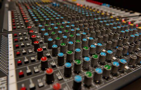 decibels: Audio mixing board shot
