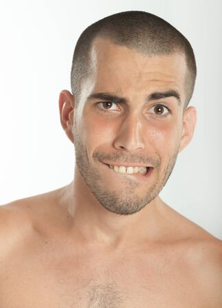 Young man with a scared expression Stock Photo - 16467055