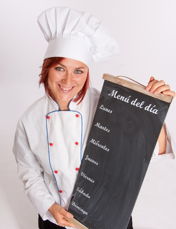 Portrait of an smiling professional female chef holding a menu slate photo