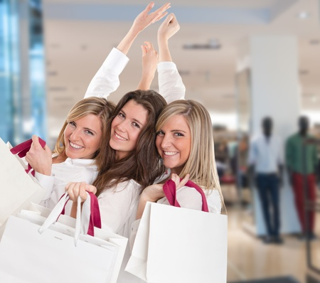 Three young women in a happy shopping expedition photo