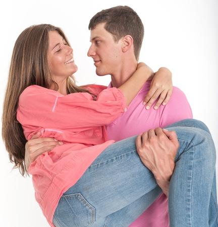 carrying girlfriend: Young man carrying his girlfriend