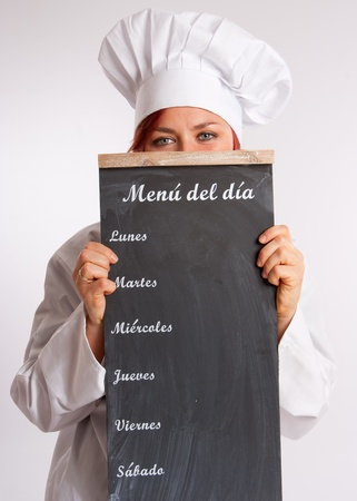 Portrait of a professional female chef holding a menu slate  photo