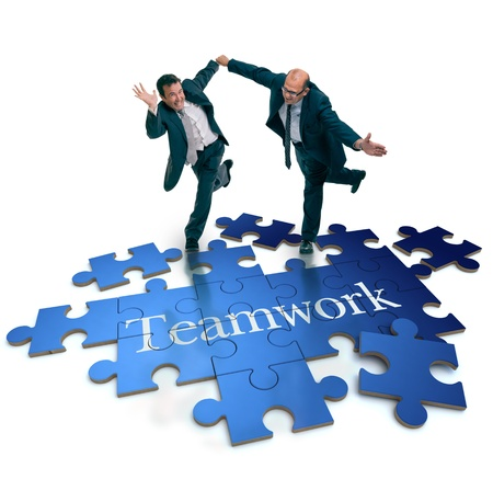 business game: Humorous shot of a pair of running businessmen on a puzzle with the word teamwork
