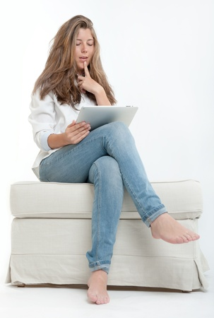 Young woman at home, using digital tablet Stock Photo - 16546273