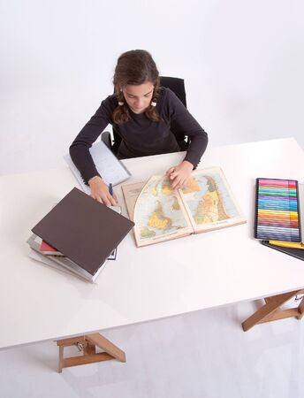 Aerial view of a young schoolgirl working at her desk Stock Photo - 16657627