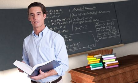 formulae: Young male teacher holding a book in a maths classroom