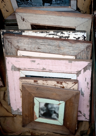 mementos: Old vintage picture frames with peeling off paint