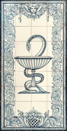 Ancient mosaic with the Pharmacy symbol the snake and the pestle photo