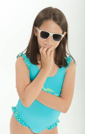 swimming costume: Young girl with sunglasses and swimming costume Stock Photo