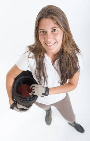 horse riding: Young woman dressed in horse riding clothes