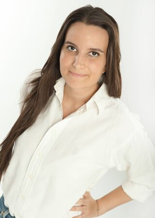 Smiling long haired brunette in a white shirt Stock Photo - 17417500