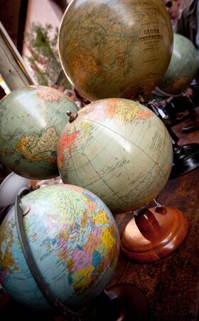 antiques: Collection of vintage world globes in an antiques shop