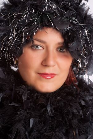black boa: Woman in party gear with feather boa Stock Photo