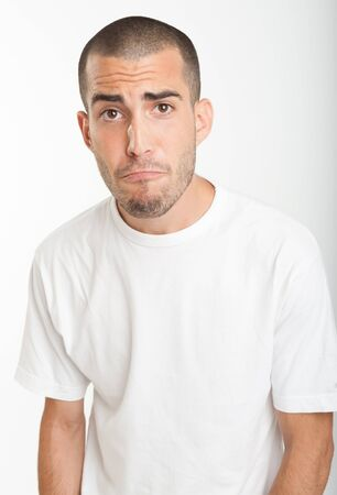Portrait of a young man with a pleading expression Stock Photo - 17572755
