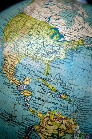 atlantic ocean: Close up shot on a vintage world globe focused on Central and North America Stock Photo