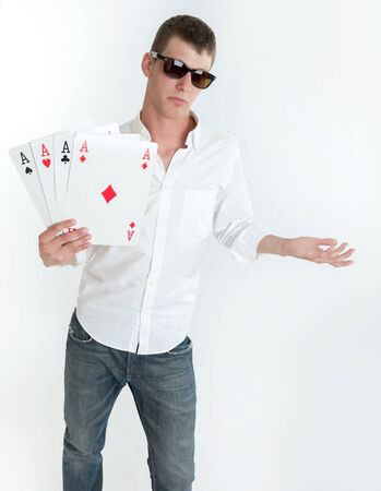 Young man holding four aces photo