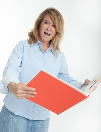 panicked: Panicked woman examining a book
