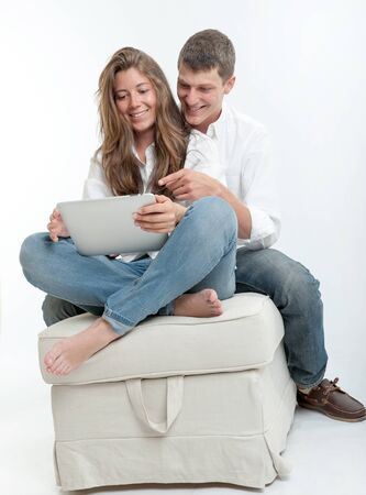 Young couple using a digital tablet Stock Photo - 17600909