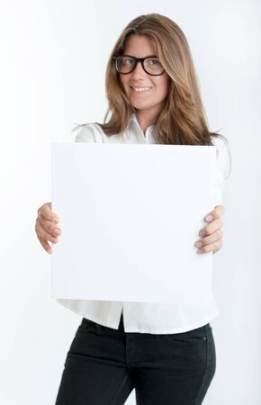 Young woman wearing glasses holding a blank square, perfect for inserting your own message Stock Photo - 17601043