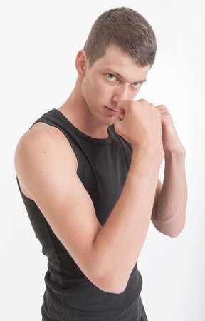 Young man in a boxing pose Stock Photo - 17851733