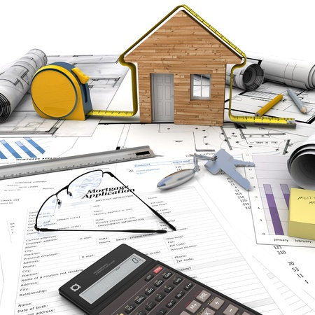 A house under construction on top of a table with mortgage application form, calculator, blueprints, etc Stock Photo - 17952428
