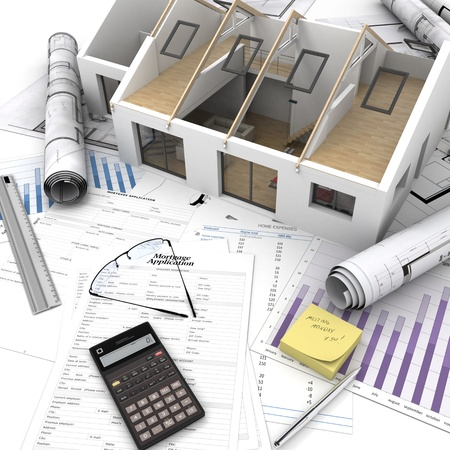 savings risk: A house on top of a table with mortgage application form, calculator, blueprints, etc