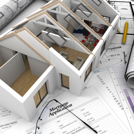 A house on top of a table with mortgage application form, calculator, blueprints, etc    photo