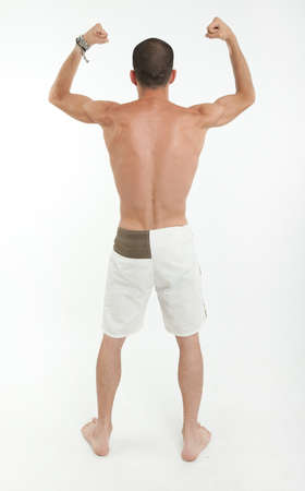 Rear view of a young man showing his biceps photo
