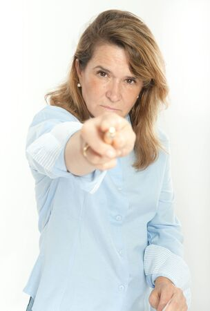 Woman with severe expression, holding a document and pointing at the camera photo