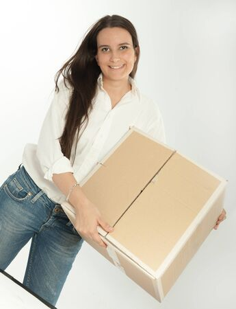 Young brunette holding a cardboard box photo