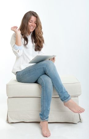 Young woman at home, using digital tablet photo