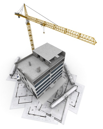 An apartment block in construction with a crane, on top of blueprints photo