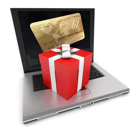 Open laptop with a credit card on the screen, and a gift box on top of the keyboard photo